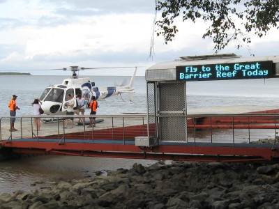 Being escorted from the helipad after offering to fly the next group of tourists out to the reef.